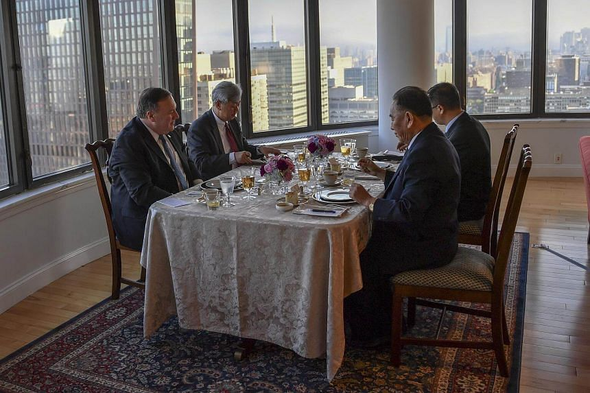 US Secretary of State Mike Pompeo (left) and North Korean envoy Kim Yong Chol (third from left) at a working dinner in New York on May 30, 2018.