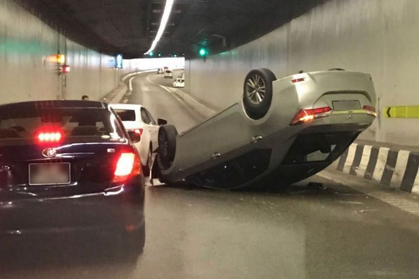 The grey car that flipped over in a tunnel on the Central Expressway. Traffic slowed to a crawl in the tunnel following the accident.