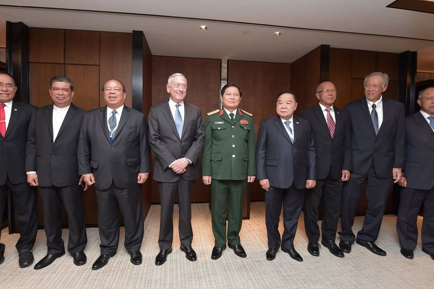 US Defence Secretary James Mattis (fourth from left) and Defence Minister Ng Eng Hen (second from right) co-chaired an informal meeting with the South-east Asian Defence Ministers.