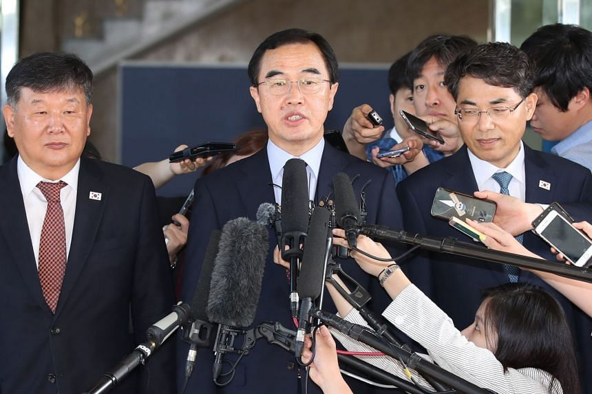 South Korean Unification Minister Cho Myoung Gyo speaks to reporters as he leaves Seoul for high-level talks with North Korea at the truce village of Panmunjom, on June 1, 2018.