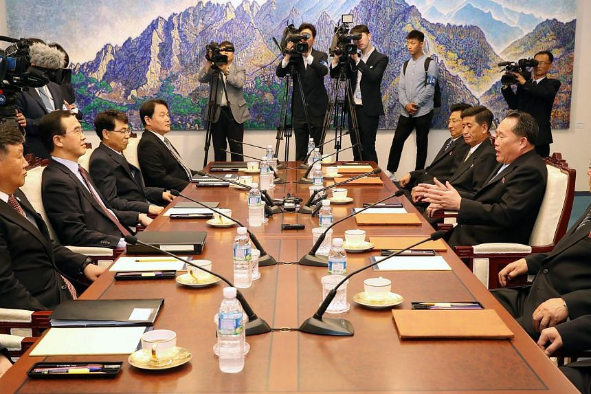 Officials from South Korea and North Korea during their meeting at the truce village of Panmunjom, South Korea, June 1, 2018.