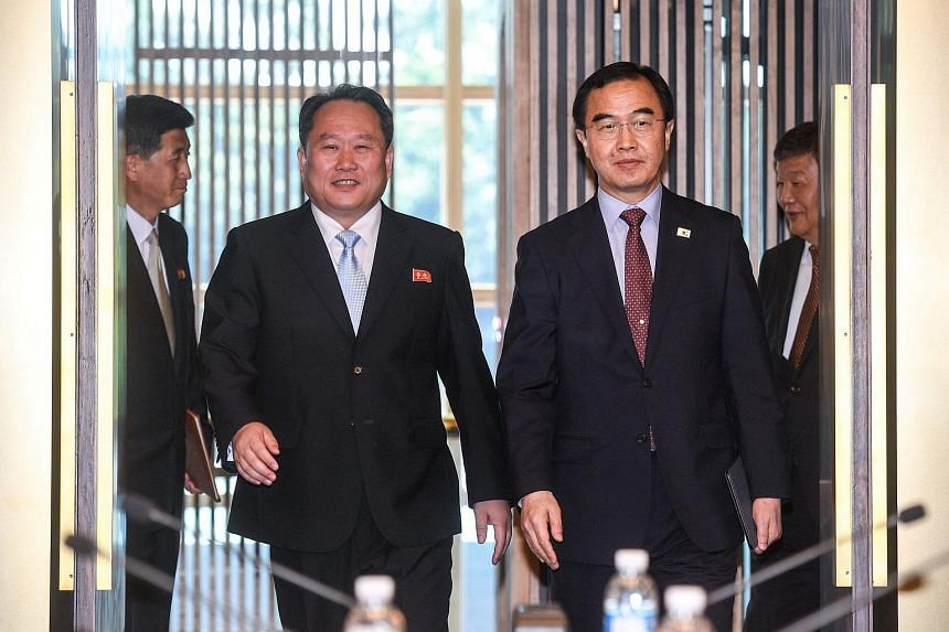 South Korean Unification Minister Cho Myoung Gyon (right) and his North Korean counterpart Ri Son Gwon arrive for their meeting at the truce village of Panmunjom, South Korea, June 1, 2018.