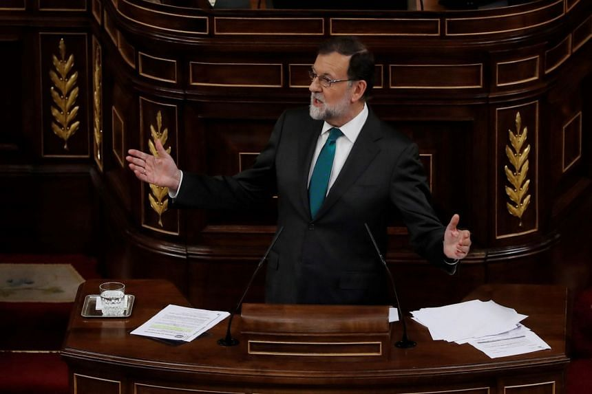Spanish Prime Minister Mariano Rajoy gives a speech during a debate on a no-confidence motion at the Lower House of the Spanish Parliament in Madrid, on May 31, 2018.