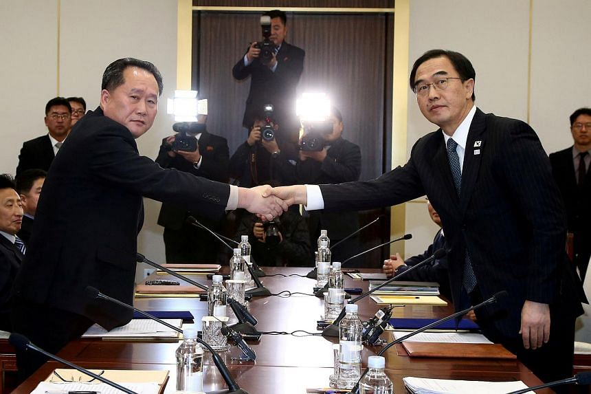 South Korea's Unification Minister Cho Myoung Gyon shakes hands with Ri Son Gwon, chairman of North Korea's Ri Son Gwon, chairman of the Committee for the Peaceful Reunification of the Country, after their meeting at Panmunjom, South Korea on Jan 9,