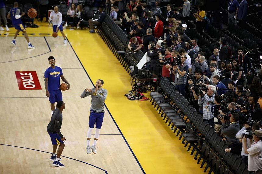 Stephen Curry #30 of the Golden State Warriors works out during the 2018 NBA Finals Media Day at ORACLE Arena on May 30, 2018 in Oakland, California.