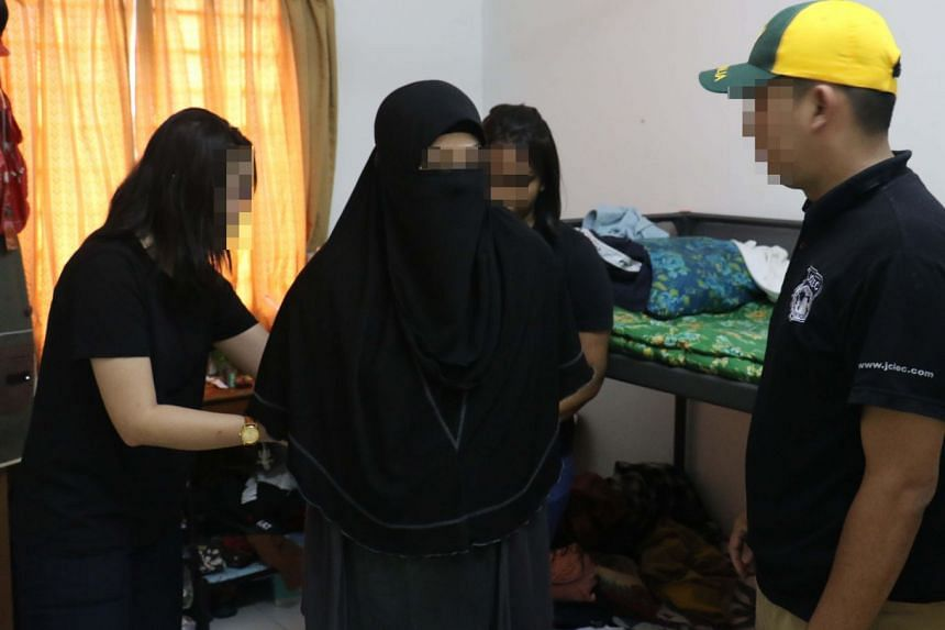 Malaysia's Special Branch's Counter Terrorism Division arresting a 51-year-old homemaker for her alleged plans to attack non-Muslims and non-Muslim houses of worship by using her car.