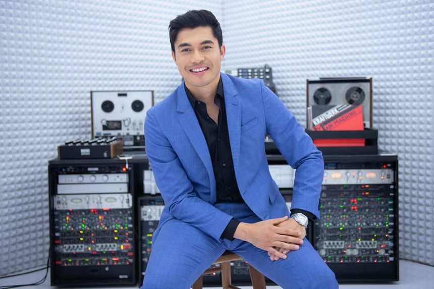 Actor Henry Golding is an ambassador for the Santos de Cartier, an iconic timepiece which made its debut in 1904 and was recently given a makeover.