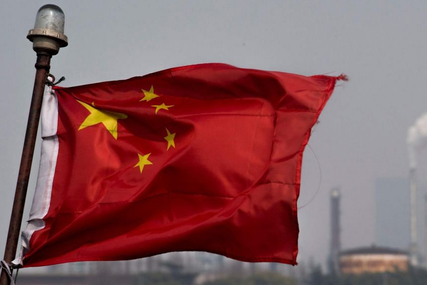 A Chinese flag fluttering in front an oil refinery in Shanghai, on March 22, 2018.