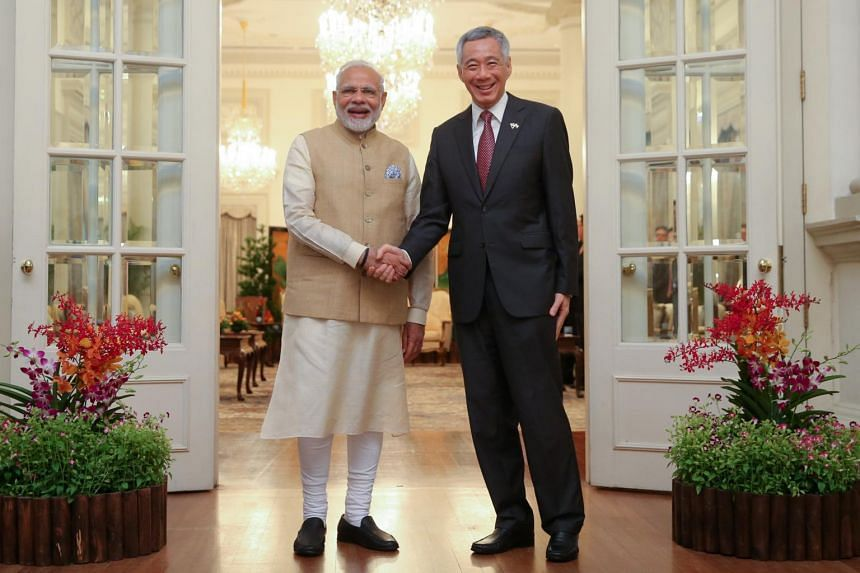 Singapore Prime Minister Lee Hsien Loong (right) shaking hands with Indian Prime Minister Narendra Modi at the Istana, on June 1, 2018.
