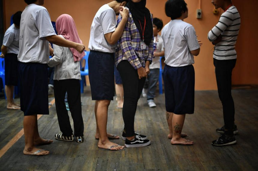 Selected female inmates at Changi Prison had the opportunity to interact with their children without a physical barrier between them, on June 1, 2018.