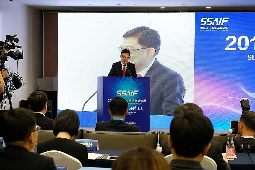 Finance Minister Heng Swee Keat delivering the opening address at the inaugural Sino-Singapore Artificial Intelligence Forum in Nanjing yesterday. The event was attended by about 350 AI experts and professionals.