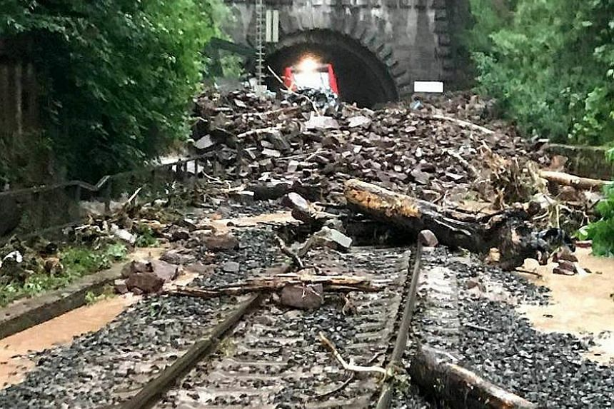 There is no way forward for this train emerging from the Wilsecker Tunnel in Bitburg-Erdorf, Germany, after a heavy storm left debris strewn along the railway tracks yesterday. A massive clean-up was underway after severe storms caused flash flooding