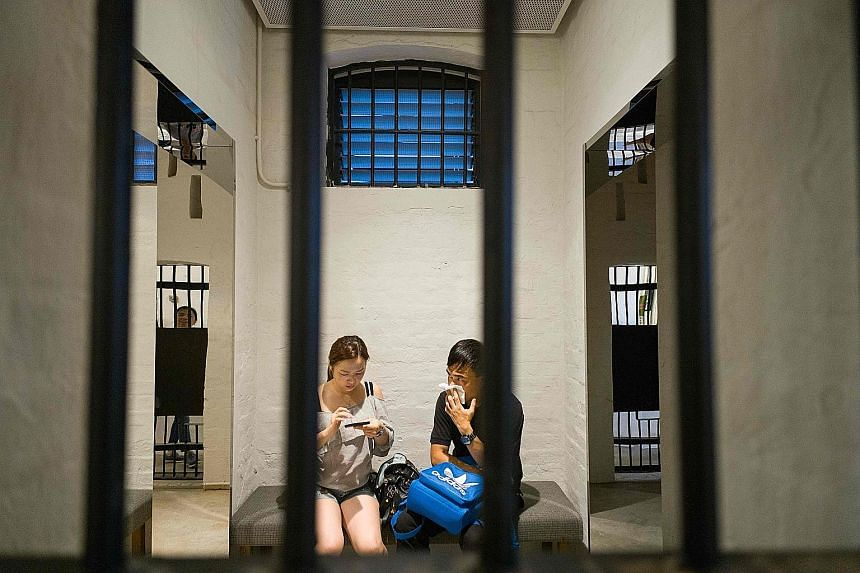 (Top, from left) Prison cells, a mock mug shot wall and other interiors at Hong Kong's Tai Kwun complex (above) are now open to the public.