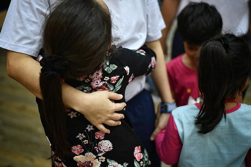 Some women inmates of Changi Prison got to hold their children at a special open visit yesterday. Normally, they see and talk to each other with a glass panel between them or via video conferencing technology.