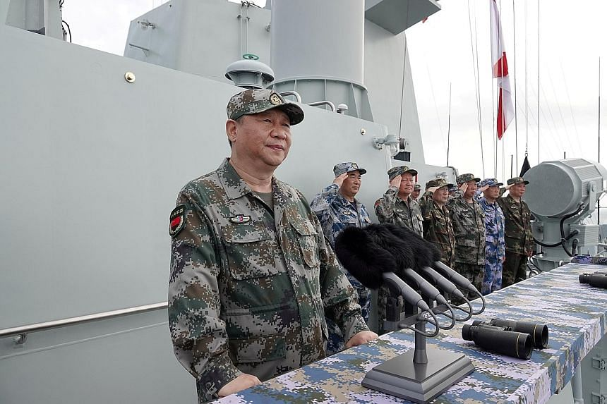 Chinese President Xi Jinping speaking after he reviewed a military display of the Chinese People's Liberation Army Navy in the South China Sea earlier this year. Beijing's main diplomatic tactic is to pose false choices and force choices between them