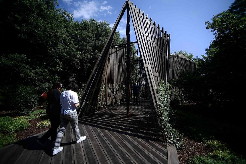 This chapel designed by British architect Norman Foster is part of the Vatican pavilion. A bamboo installation (above) at Building A Future Countryside, China's pavilion. Titled In Statu Quo, the Israeli installation (left) examines the negotiation o