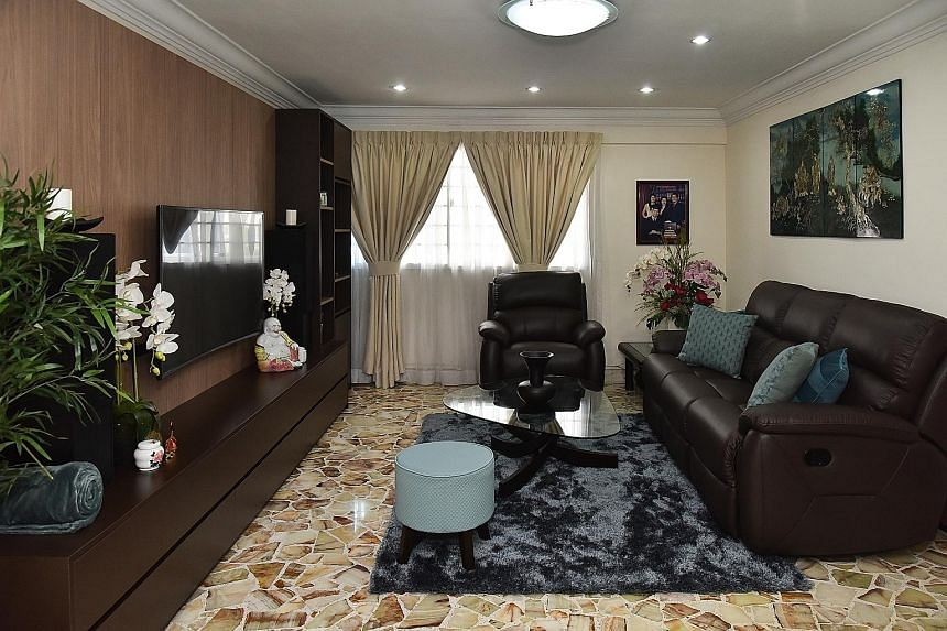 The original look of the living room, with its green wall (above). The living room of Mr Ng Seng Kee and Madam Helen Wong (both left, with their daughter Vivien Ng and granddaughter Katelyn) has a new sofa, TV console set and coffee table.