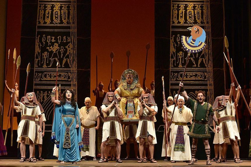 Set in ancient Egypt, Aida boasts a big set with lush costumes (above) as well as a big cast, including Martin Ng and Jee-Hye Han (both left).