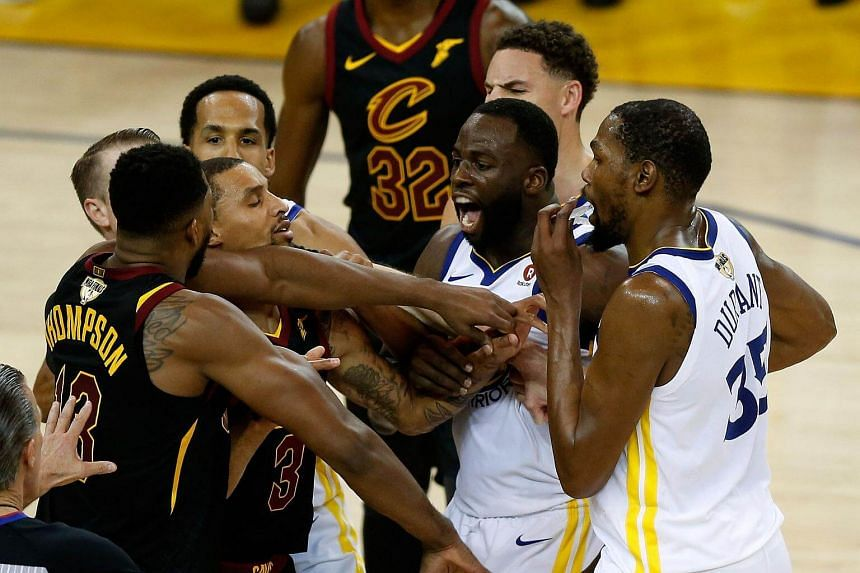 Cleveland Cavaliers' Tristan Thompson and the Golden State Warriors' Draymond Green exchange words in overtime during their NBA Finals opener at Oracle Arena in Oakland on May 31, 2018.