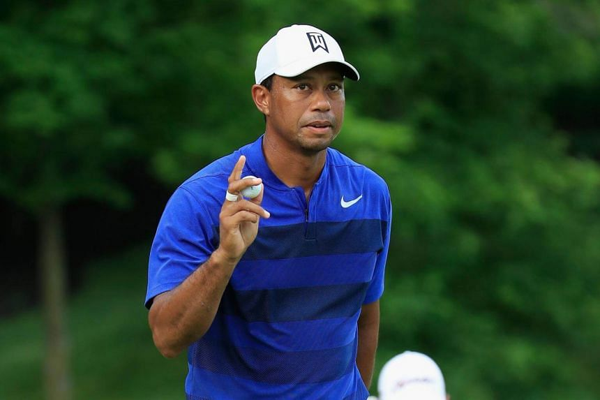 Tiger Woods waves to the crowd after making a birdie on the 15th hole during the second round of The Memorial Tournament Presented by Nationwide at Muirfield Village Golf Club, on June 1, 2018.