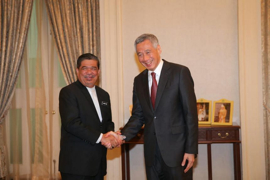 Malaysia Minister of Defence Mohamad Sabu (left) calls on Prime Minister Lee Hsien Loong at the Istana on the sidelines of Shangri-La Dialogue on June 1, 2018.