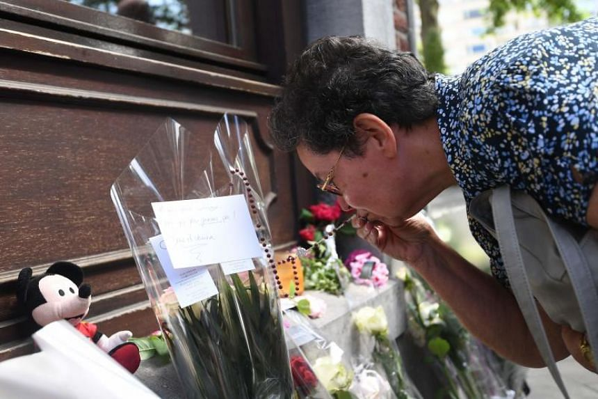 Bernadette Hennart, the mother of killed policewoman Soraya Belkacemi kisses a rosary as she pays tribute to her daughter, on May 30, 2018.