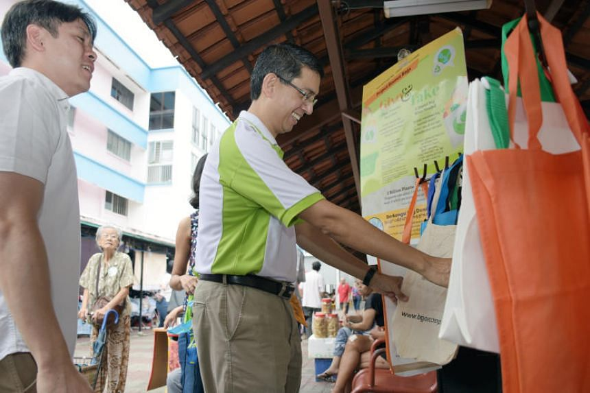 Nee Soon GRC MPs Louis Ng Kok Kwang and Faishal Ibrahim at the launch of the Bounce Bags Initiative on June 2, 2018.