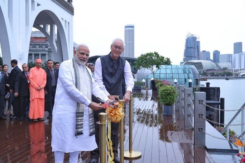 Emeritus Senior Minister Goh Chok Tong and India Prime Minister Narendra Modi at a ceremony at Clifford Pier to unveil a plaque marking the waters where the ashes of Mahatma Gandhi were immersed.