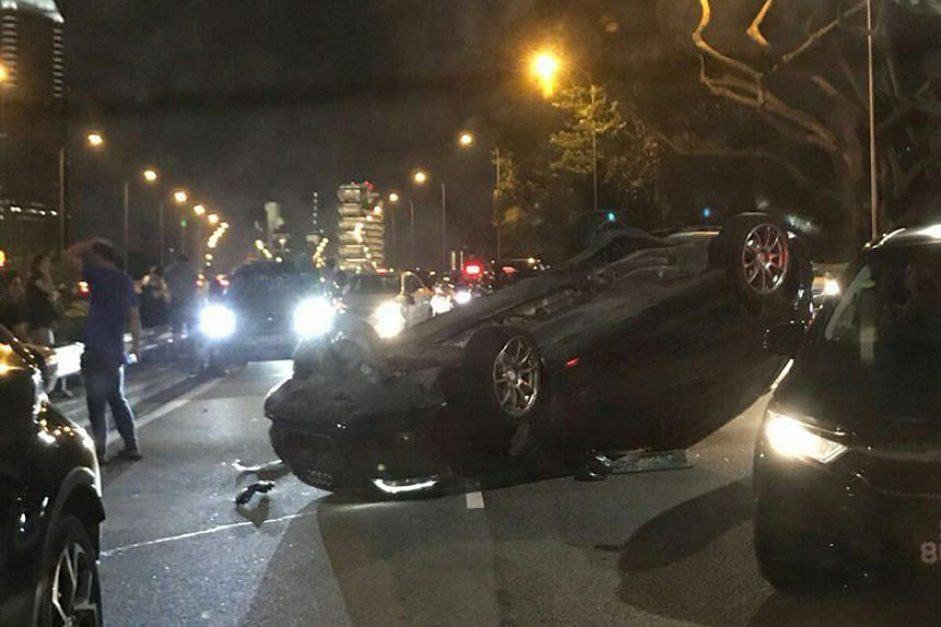 A black Audi car flipped over and was found overturned on its back in Sheares Avenue.