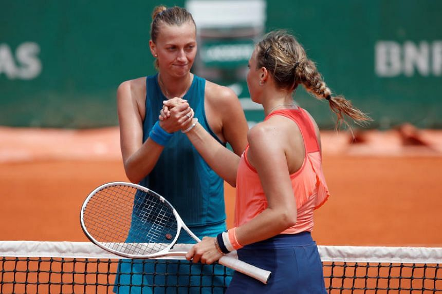 Petra Kvitova (left) shakes hands with Anett Kontaveit after their third round match  in the French Open in Paris on June 2, 2018.