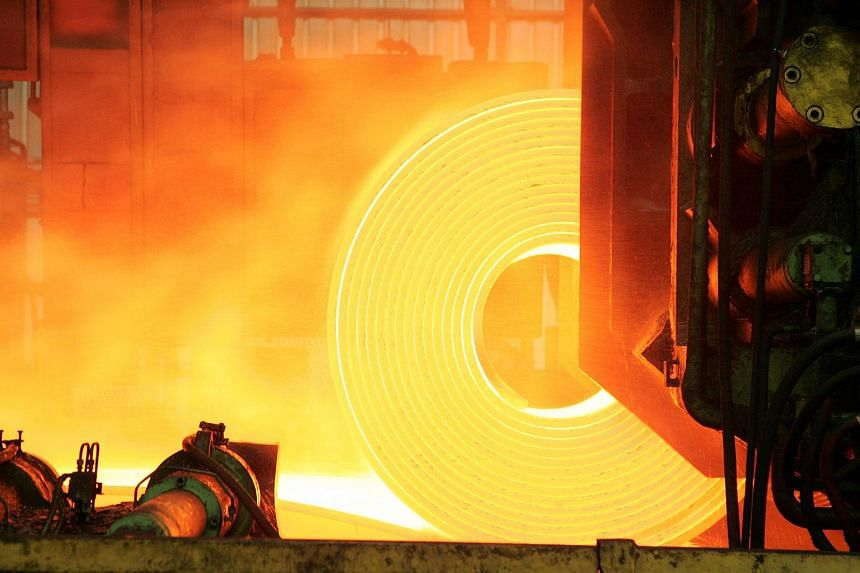 Red hot steel is rolled into coils at a steel factory in Brazil.