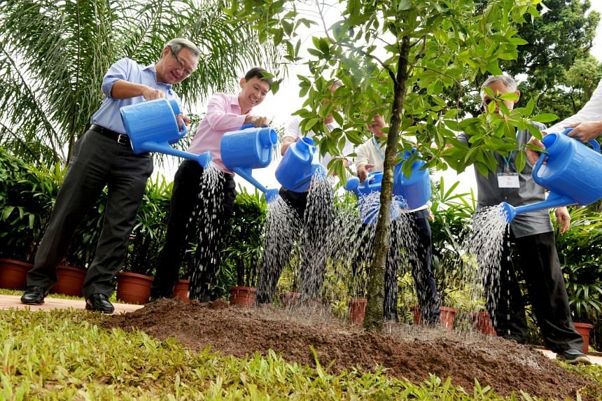 (From left) JTC chairman Loo Choon Yong, Senior Minister of State for Trade and Industry Chee Hong Tat, JTC CEO Ng Lang, NParks CEO Kenneth Er and JTC alumni president James Tan. Mr Chee planted a tree yesterday at Jurong Town Hall's Garden of Fame.