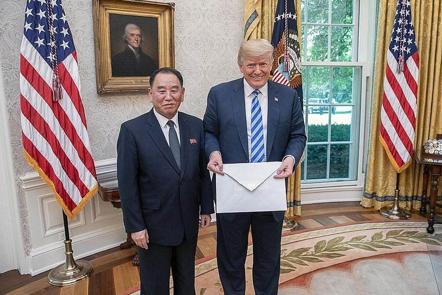 US President Donald Trump with North Korean official Kim Yong Chol, who delivered a letter from Mr Kim Jong Un, in the Oval Office at the White House on Friday.