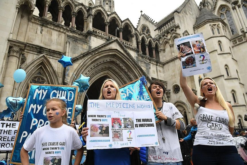 Supporters of the fight to save baby Charlie Gard at a rally outside the High Court in London last July.