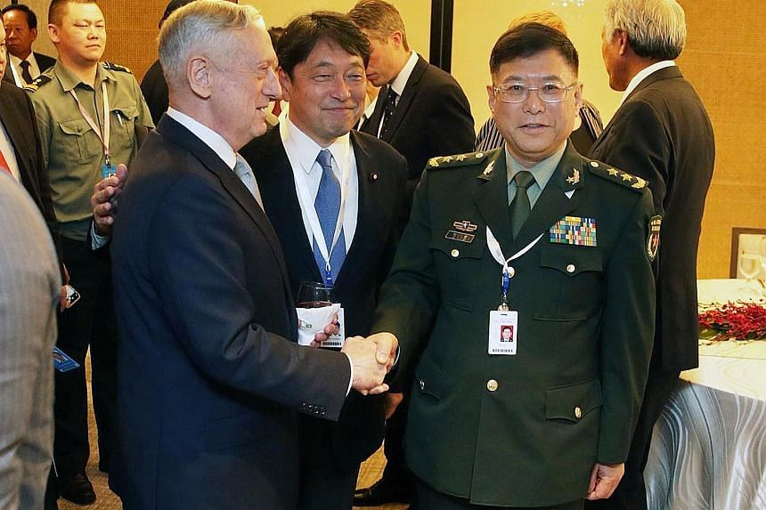 US Defence Secretary James Mattis, Japanese Defence Minister Itsunori Onodera and China's Lt-Gen He Lei at the dialogue. Mr Mattis said China's placement of weapon systems in the South China Sea is tied directly to military use for the purpose of int