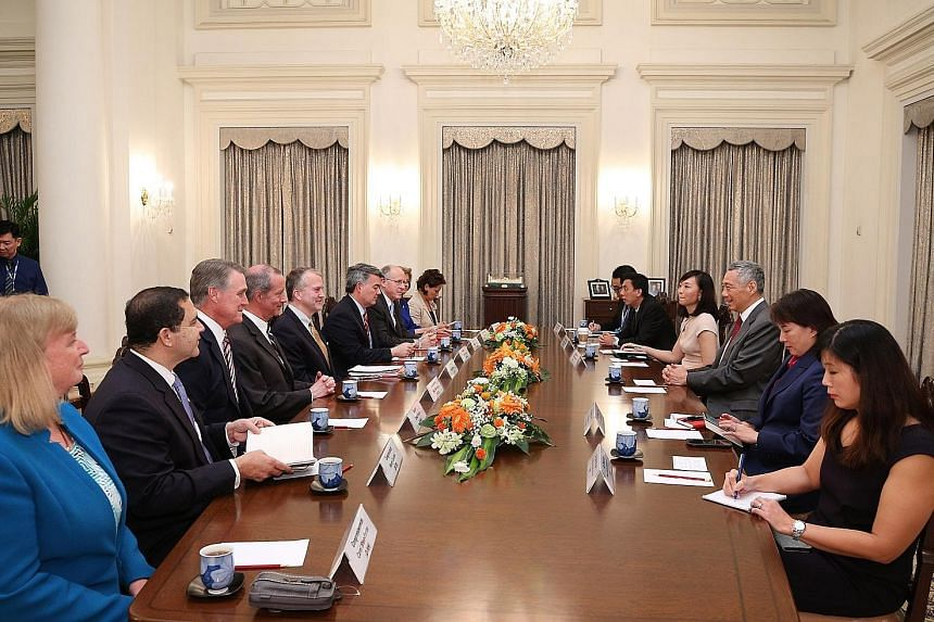 US Congress members calling on Prime Minister Lee Hsien Loong yesterday. They spoke about regional and international developments, and reaffirmed the importance of the US' continued engagement of the region.