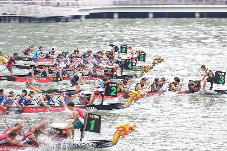Nanyang Junior College surging to the front to win the Boys' A Division DB12 dragonboat final at the DBS Marina Regatta yesterday. Less than two seconds separated all six teams.