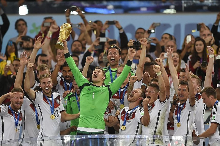 Germany goalkeeper Manuel Neuer lifting the World Cup trophy at the Maracana in 2014 after the 1-0 extra-time victory over Argentina. The captain is back from injury to lead Germany's title defence.