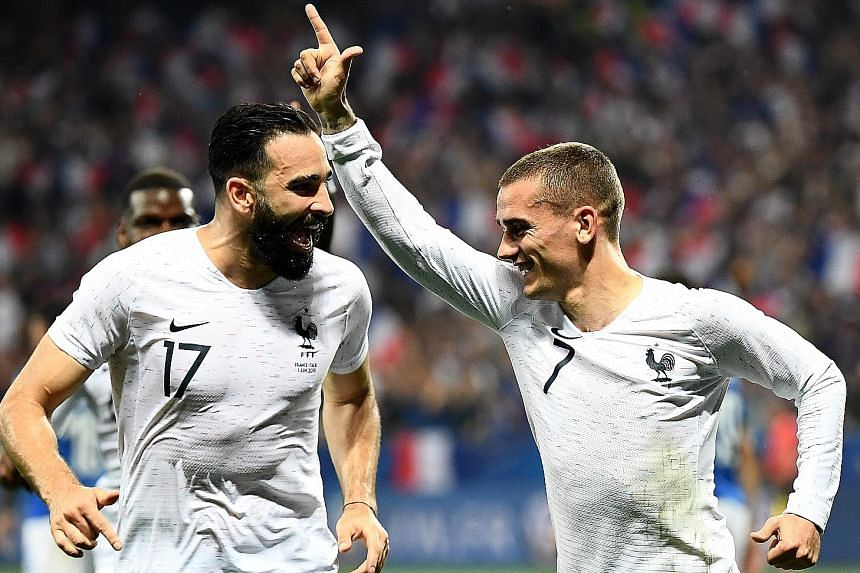 Above: France forward Antoine Griezmann (right) celebrates with team-mate Adil Rami after converting a penalty in the 3-1 win against Italy in the friendly in Nice on Friday. The comfortable victory followed France's 2-0 triumph against the Republic of Ir
