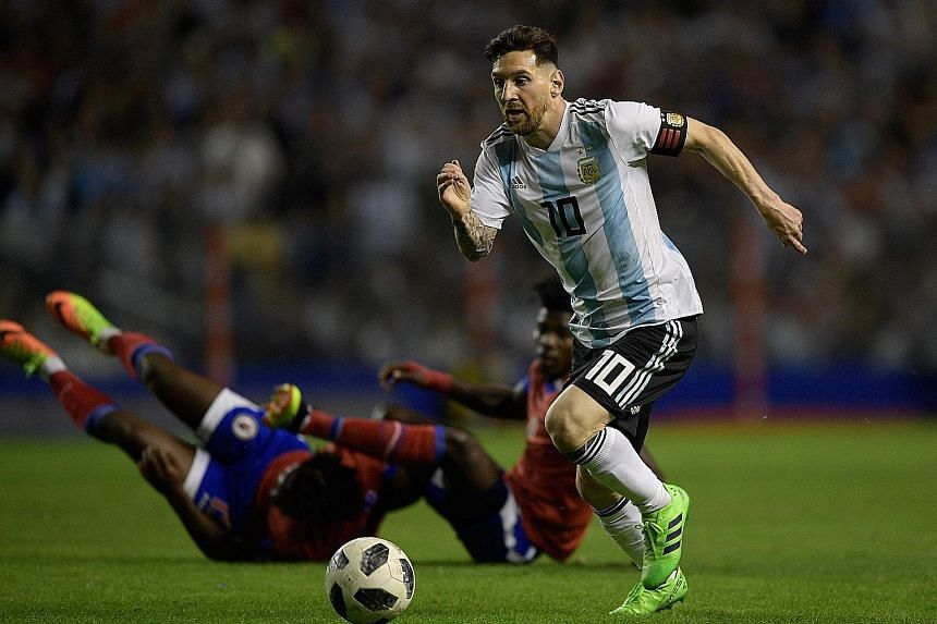 Lionel Messi leaving Haiti players in his wake as he scored a hat-trick in a World Cup warm-up match on Tuesday. The star striker has not won a major trophy with Argentina despite reaching the finals of the 2014 World Cup and the Copa America in 2007