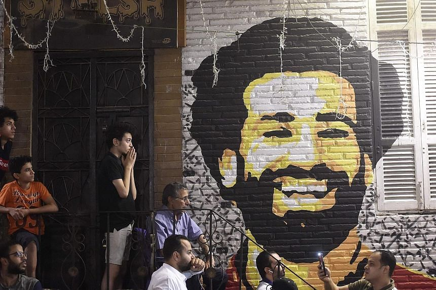 A wall painting of Mohamed Salah in a Cairo coffee shop, where patrons were willing their fellow Egyptian on to glory with Liverpool against Real Madrid in the Champions League final. They would end up doubly disappointed; the Reds forward departed e