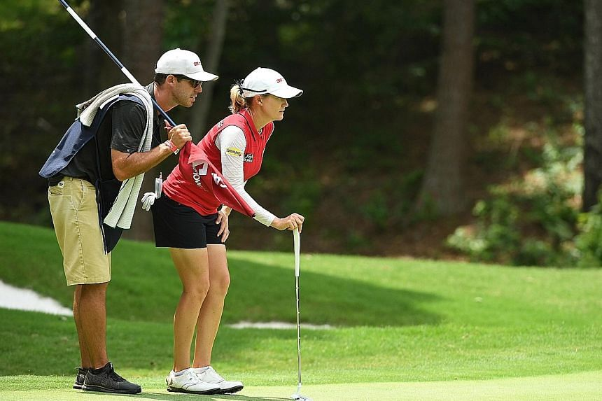 Sarah Jane Smith looking over the seventh green with caddie and husband Duane, during the second round of the US Women's Open Championship golf tournament at Shoal Creek on Friday.