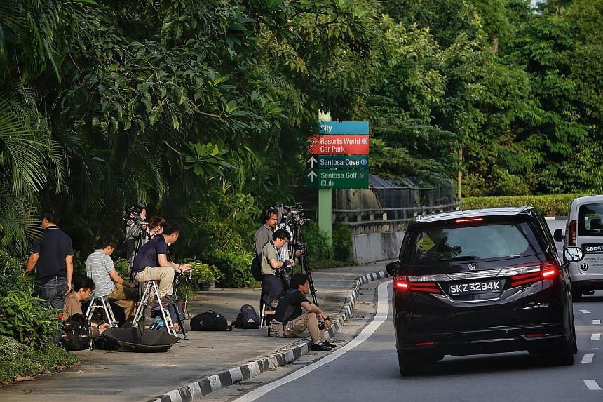 Foreign media (far left) staking out the road that leads to Capella Hotel on Sentosa, where the summit between US President Donald Trump and North Korean leader Kim Jong Un is likely to be held. Mr Kim could stay at The Fullerton Hotel (left) during