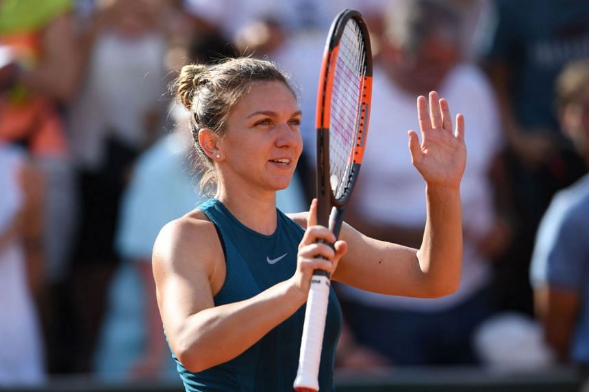 Romania's Simona Halep celebrates after her victory over Germany's Andrea Petkovic at the end of their women's singles third round match on day seven of The Roland Garros 2018 French Open tennis on June 2, 2018.