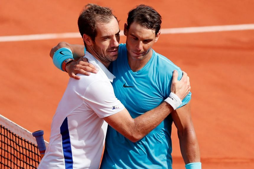 Rafael Nadal of Spain with Richard Gasquet of France after winning the men's third round match during the French Open tennis tournament at Roland Garros in Paris, France on June 2, 2018.