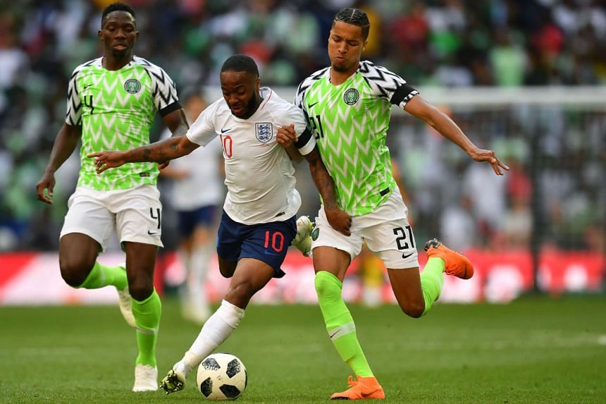 England's midfielder Raheem Sterling (centre) vies with Nigeria's defenders Tyronne Ebuehi (right) and Kenneth Omeruo (left) during the International friendly football match between England and Nigeria at Wembley stadium, on June 2, 2018.