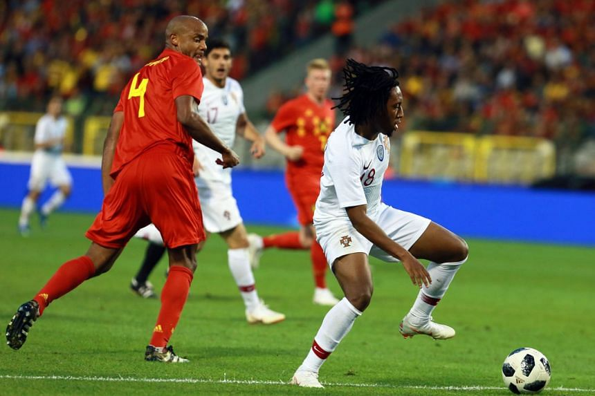 Vincent Kompany (left) of Belgium in action against Gelson Martins (right) of Portugal during the international friendly football match between Belgium and Portugal at the King Baudouin stadium in Brussels, Belgium, on June 2, 2018.