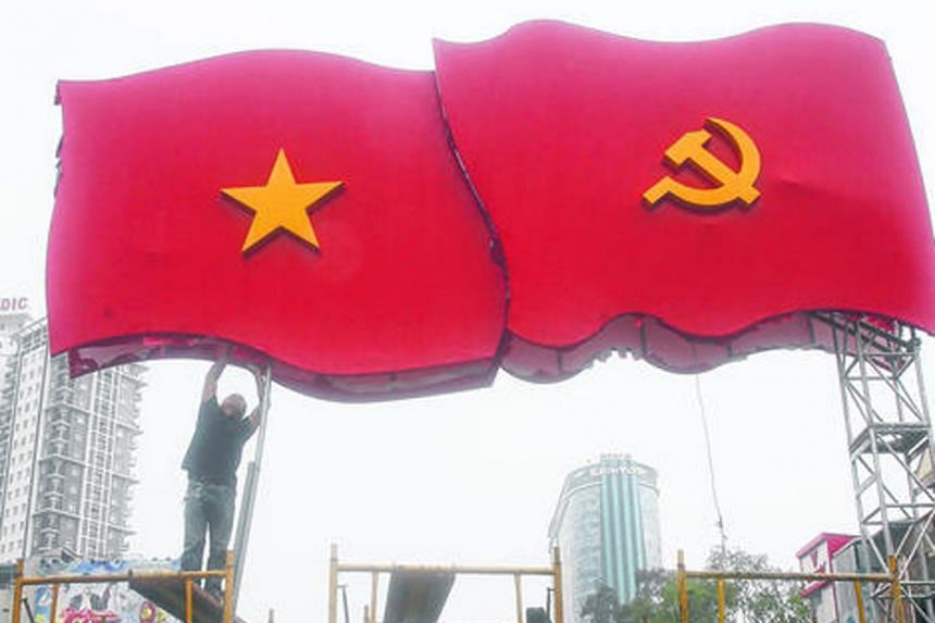 The Vietnamese national flag (left) and communist flag. In Vietnam, the inspection committee investigates wrongdoing before making a decision on how to sanction those found responsible.