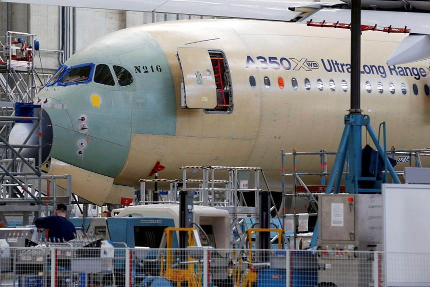 An Airbus A350 X UltraLong Range aircraft is pictured on its final assembly line at Airbus headquarters in Blagnac, France, on March 21, 2018.