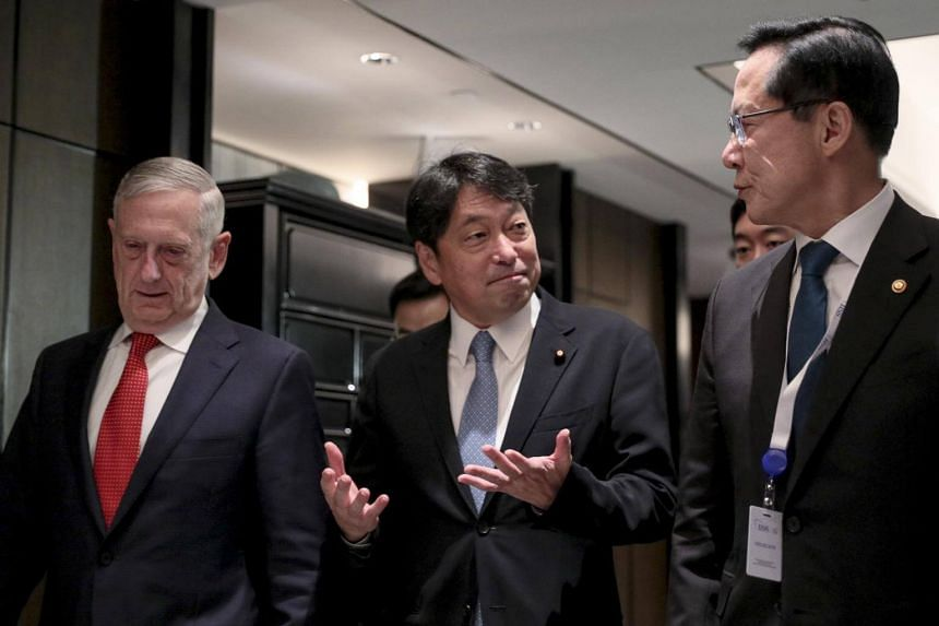 US Secretary of Defense James Mattis (left) leaving a trilateral meeting Japanese Defense Minister Itsunori Onodera (centre) and South Korean National Defense Minister Song Young-moo on the sidelines of the IISS 17th Asia Security Summit in Singapore